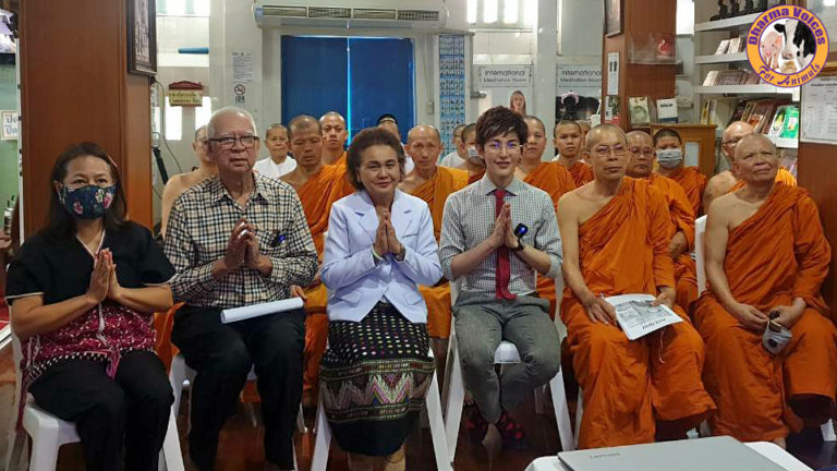 Banks and Dr. Ling sitting with monastics