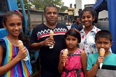 Saturday May 5th 2018, DVA's Sri Lanka project hosted a vegan icecream social on the streets of Colombo, Sri Lanka and gave out two thousands frozen soy cones. Here is a happy family enjoying the food on a hot day.